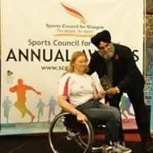 Sarah Baillie receiving Disability Coach of the Year award