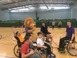 Mascot Leaping Leo joins in Wheelchair Basketball with some of the pupils and coaches