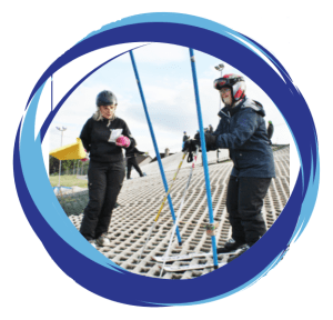 Teacher and student on artificial ski slope