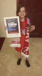 Keeley with her medal certificate