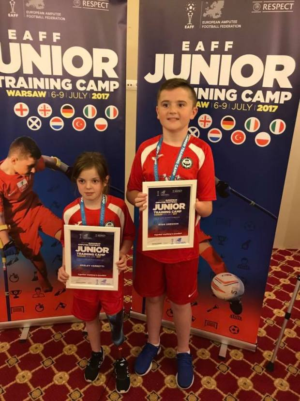 Keeley and Ryan with their medals