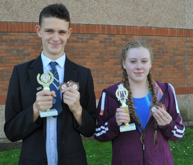 Matthew and Cerys with their trophies