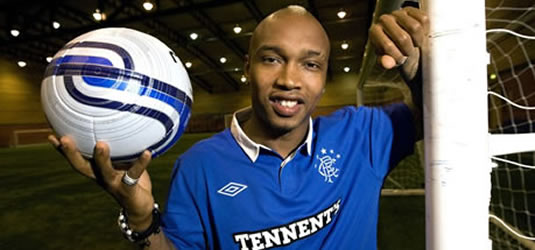 El Hadji Diouf poses in a Rangers top