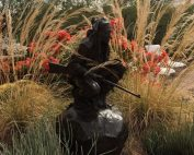Sculpture of a Native American Displayed Beautifully in a garden