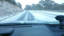 Snow over the New England Highway near Ben Lomond