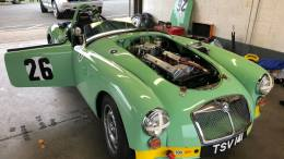 An MGA siting inside a pit bay on the Island at Brands Hatch