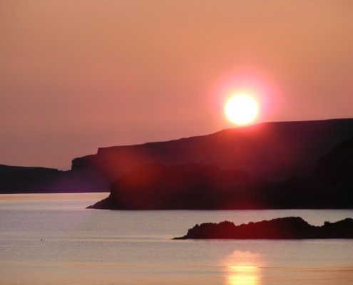 Sunsets over Scourie bay can be colourfu