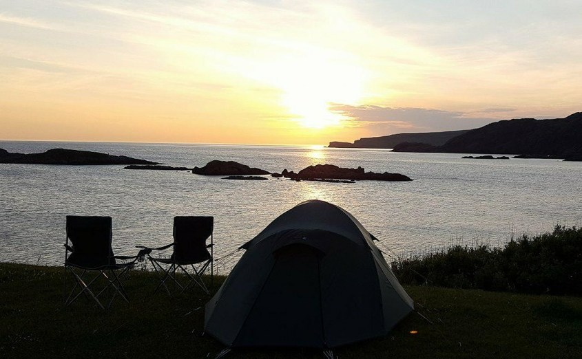 Sunset over tents at campsite