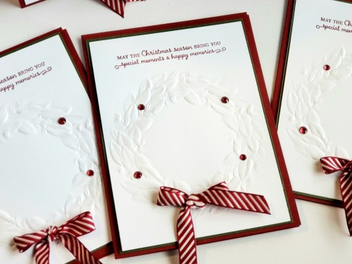 Clean and simple Christmas card idea using the Stampin Up Seasonal Wreath embossing folder. Wreath Christmas card idea.