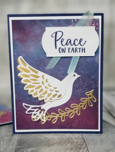 The Stampin Up Dove Of Hope bundle makes beautiful religious Christmas cards, such as this amazing one with a watercolor background technique.