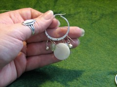Adding the bead drops to the earring finding.