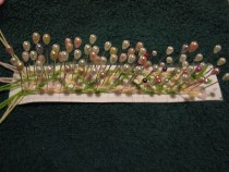 Length of net stitch bobbin lace still on pins