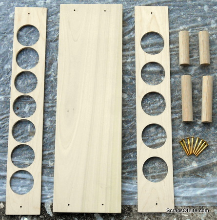 Cut and drilled pieces of wood, pre-assembly