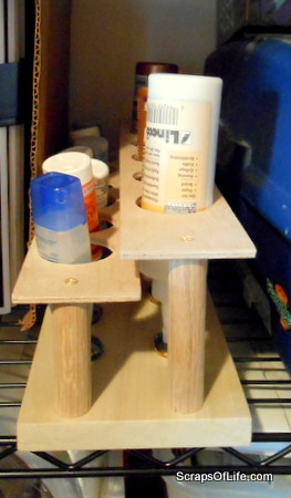 Glue stand, filled, slid into a narrow spot on a shelf