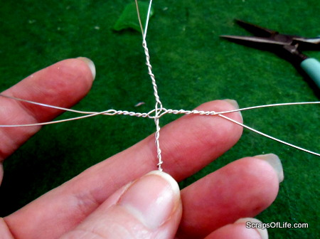 The twisted beginnings of a wire-wrapped ring.