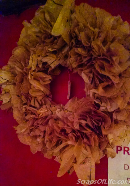 A wreath made of old sewing pattern tissue--brilliant! (and I could totally make one for myself)