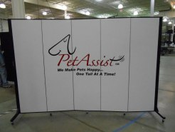 Pet Assist we make pets happy one tail at a time logo on a white 5 panel Screenflex Room Divider