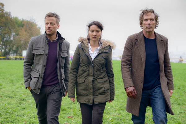Pictured: (l-r) Tom Wlaschiha as Sebastian Berger, Moon Dailly as Anne-Marie San, William Fichtner as Carl Hickman -- (Photo by: Etienne Chognard/Tandem)