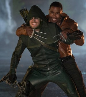 Pictured (L-R): Stephen Amell as Oliver Queen and Michael Jai White as Bronze Tiger -- Photo: Jack Rowand/The CW