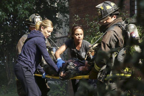 "Pictured: (l-r) Lauren German as Leslie Shay, Monica Raymund as Gabriela Dawson, Yuri Sardarov as Brian ""Otis"" Zvonecek -- (Photo by: Elizabeth Morris/NBC)"