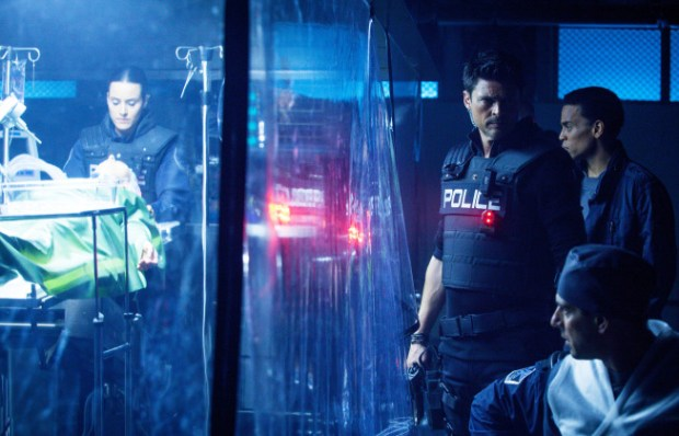 Det. John Kennex (Karl Urban, C) and Dorian (Michael Ealy, second from R) interrupt a transplant operation. Cr: Liane Hentscher/FOX