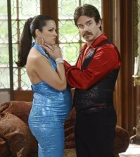 Pictured (L-R): Paula Garces and Eddie McClintock -- Photo by: Steve Wilkie/Syfy