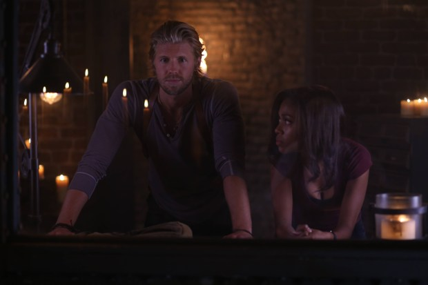 "Nick (guest star Matt Barr, L) and Abbie (Nicole Beharie, R) capture a demon in the ""And The Abyss Gazes Back"" episode of SLEEPY HOLLOW. Co. CR: Fred Norris/FOX"