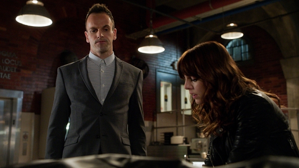 Pictured: Jonny Lee Miller as Sherlock Holmes and Ophelia Lovibond as Kitty. Image © CBS