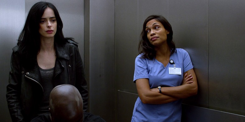 (L-R) Krysten Ritter as Jessica Jones, Rosario Dawson as Claire Temple | Photo © Netflix