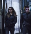 Pictured (L-R): Juliana Harkavy as Tina Boland and Stephen Amell as Oliver Queen/The Green Arrow -- Photo: Cate Cameron/The CW