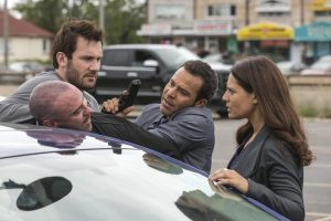 "TAKEN -- ""Off Side"" Episode 103 -- Pictured: (l-r) Alan Van Sprang as Mike Gilroy, Clive Standen as Bryan Mills, Michael Irby as Scott, Monique Gabriela Curnen as Becca Vlasik -- (Photo by: Panagiotis Pantazidis/NBC)"