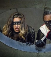 "Arrow -- ""Honor Thy Fathers""  Pictured (L-R): Juliana Harkavy as Tina Boland/Dinah Drake and Echo Kellum as Curtis Holt/Mr.Terrific -- Photo: Jack Rowand/The CW"