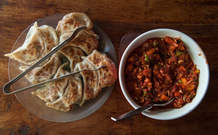 Chicken momos and tomato chutney at Orchard