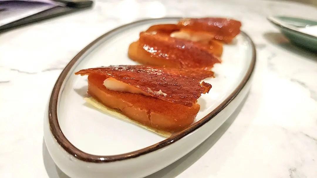 Crispy Bun with Sliced Peking Duck.