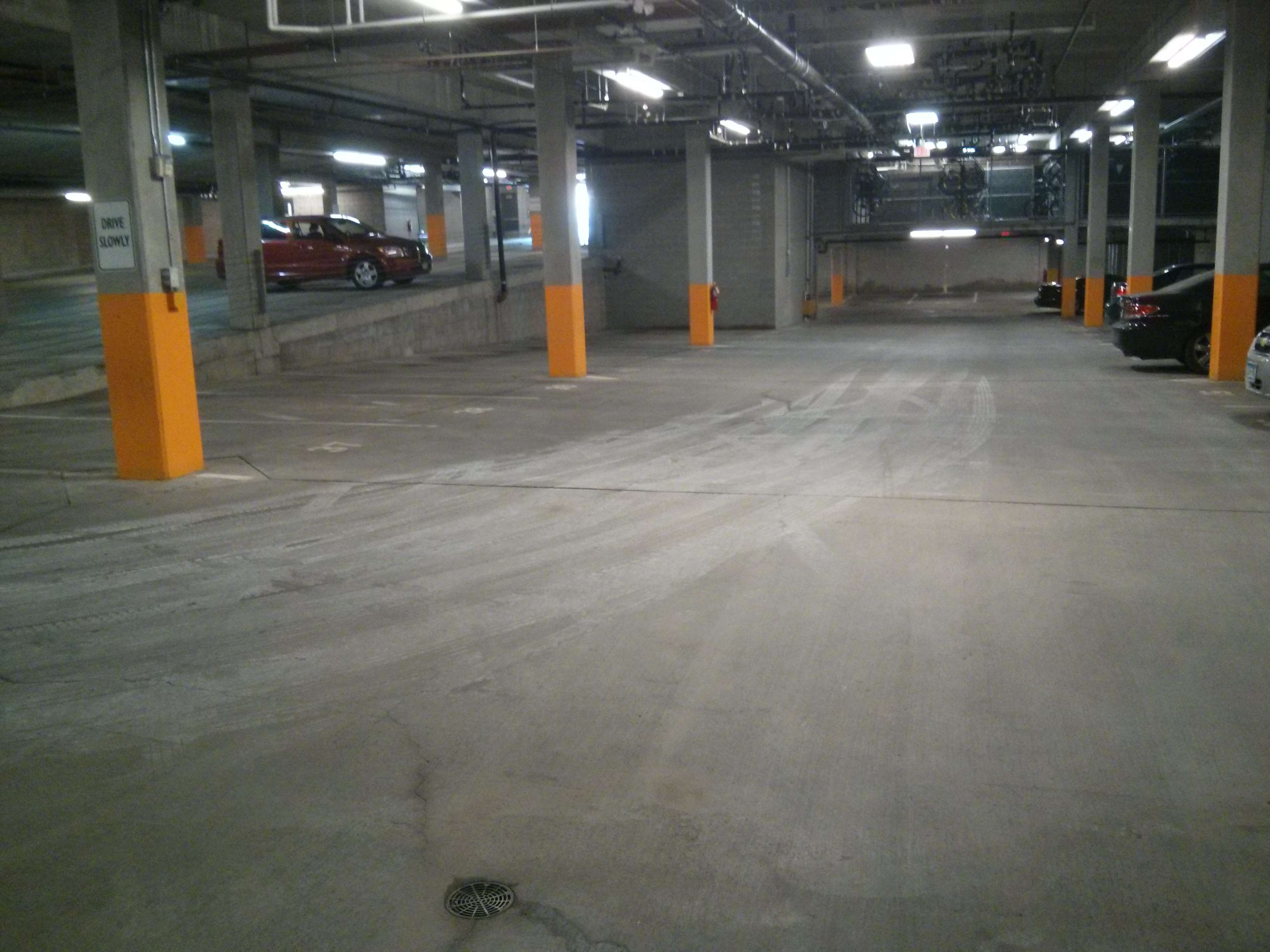 Parking garage concrete floor pressure washing cleaning for Garage floor maintenance