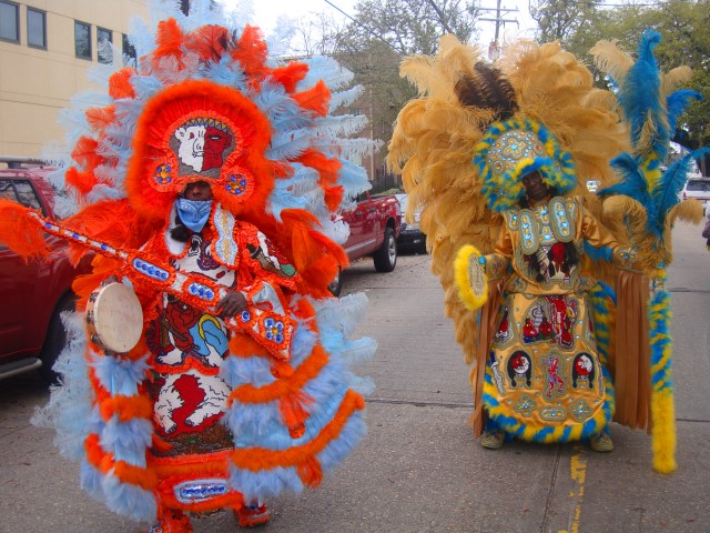 Oh, just two Mardi Gras Indians strolling down the street, that's all