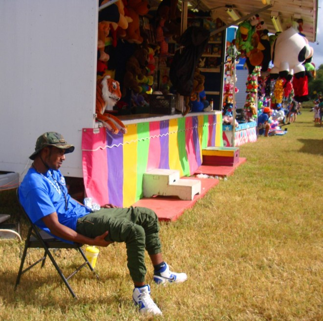 A Carny Takes A Break At 2016 Oyster Festival In Violet