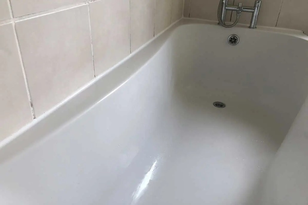 After - New silicone sealant applied to bath
