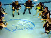 PADI Certification | Beginning Scuba Diving Lessons | PADI Open Water Diver Certificatioin Class enjoying the heated indoor pool at Scuba Center in Eagan, Minnesota. | PADI Open Water Diver Certification classes are small, limited to a maximum of eight to ten students per PADI Instructor during pool (Confined Water) training, to assure personal attention and fun while learning to Scuba dive. | Certification classes offered in Eagan, Minnesota and Minneapolis, Minnesota
