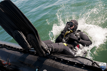 What is the difference between a wet suit and a dry suit