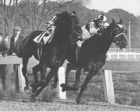 Seabiscuit defeats Triple Crown winner War Admiral in 1938 match race
