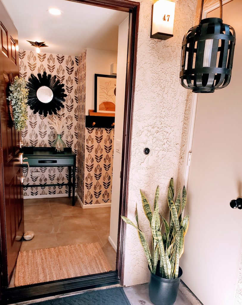 New plant for outside  New outside and inside rug New lantern New fresh entryway