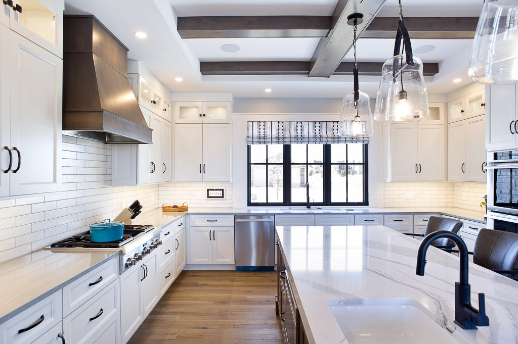 beautiful white kitchen with exposed beams