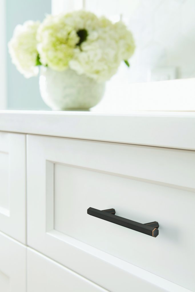 Beautiful hardware with white cabinetry.