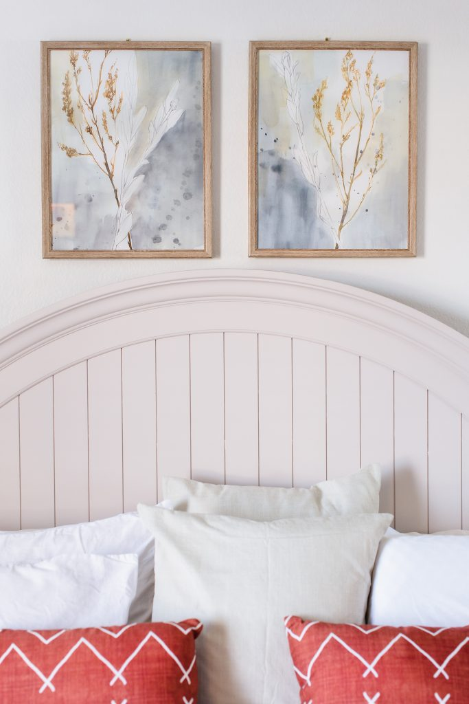 Headboard, artwork above and the pillows