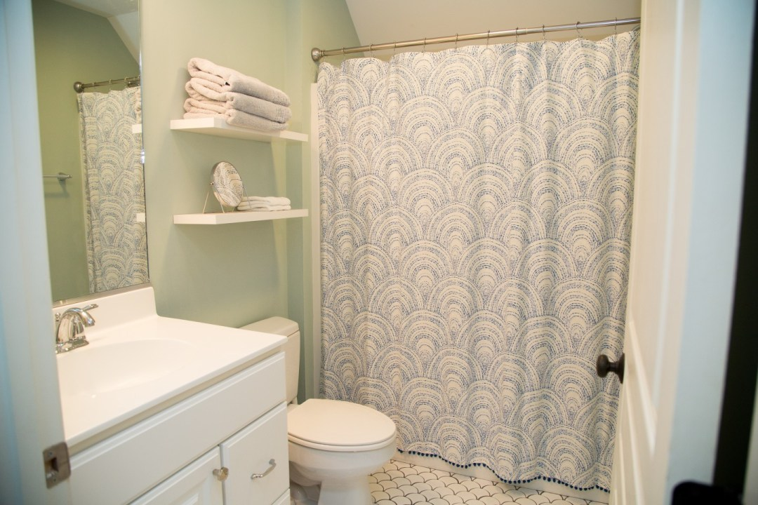 Bathroom with White Vanities, White Tiles and Shower Curtain