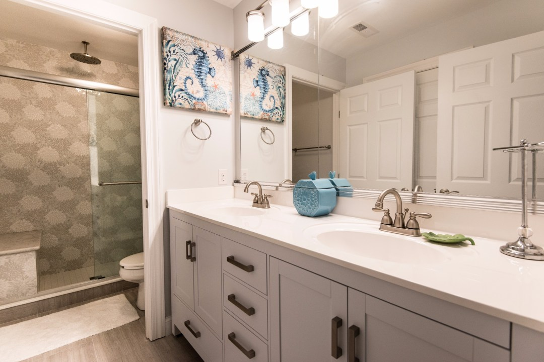 Bathroom Remodel in Bethany Lakes, Bethany Beach DE with Shower Wall Tiles, Estrella Be Bop White Gloss Glass Mosaic and White Vanities