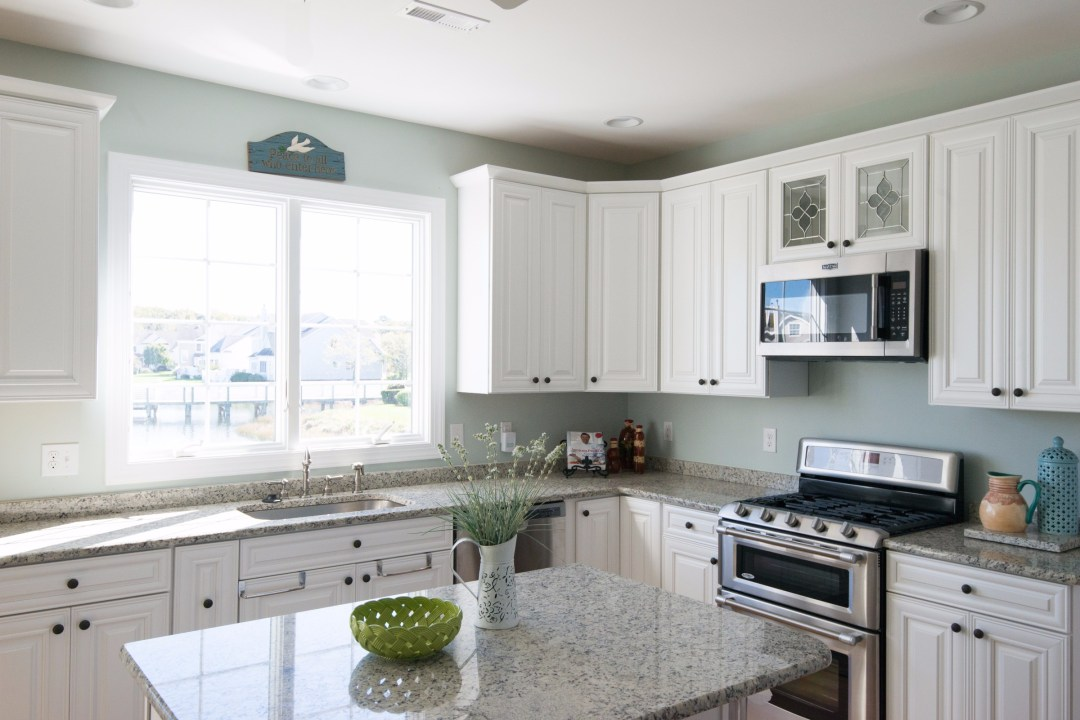 Kitchen Remodel in Bethany Lakes, Bethany Beach DE with Blanco Tulum Granite Countertop and White Cabinets