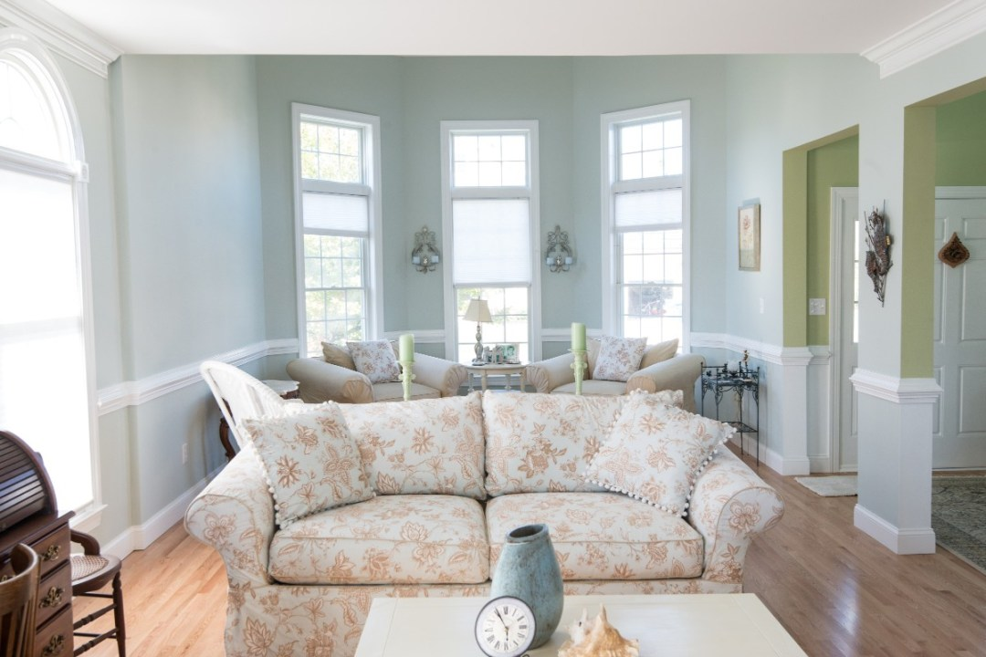 Bethany Lakes Renovation Bethany Beach, DE with Large Sofa, Vintage Furniture and Tall Windows