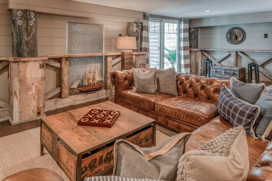 Renovation in Bora-Bora, Fenwick Island DE with Warm Colors, Large Leather Sofa and Decorative Ship